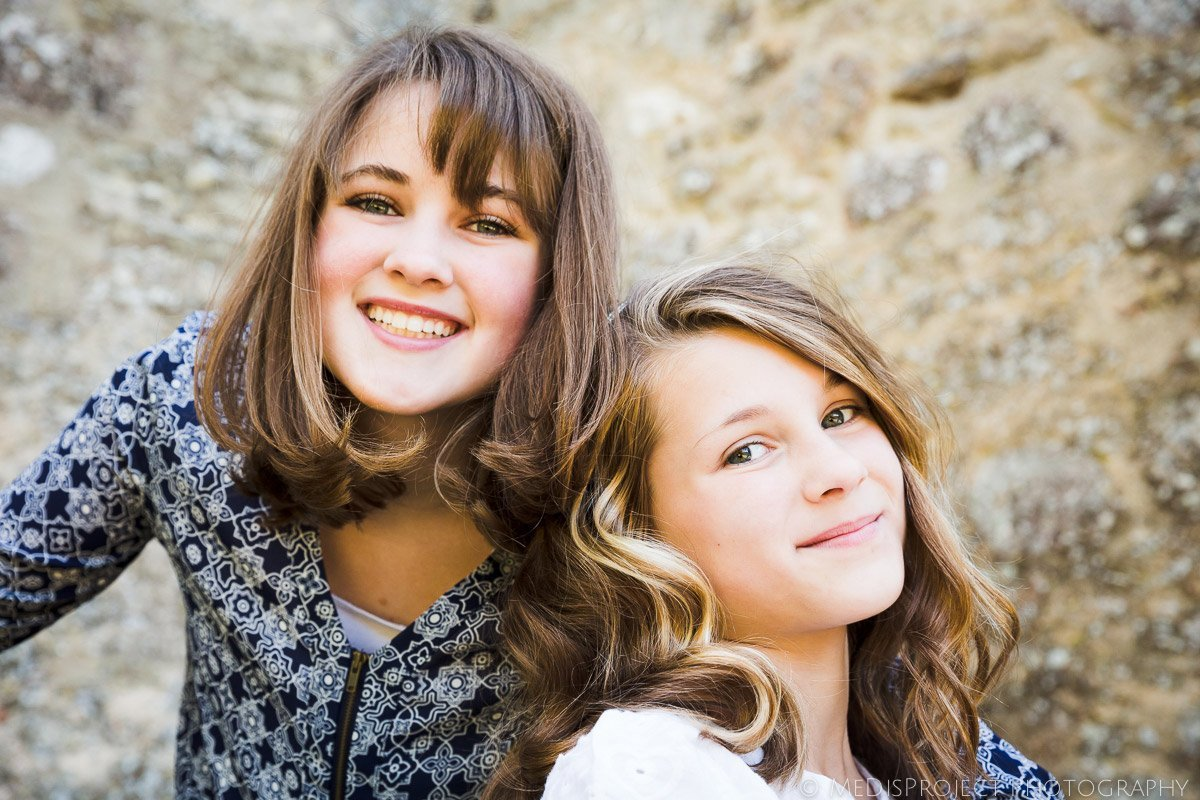 sisters portrait during a family photo session in Tuscany