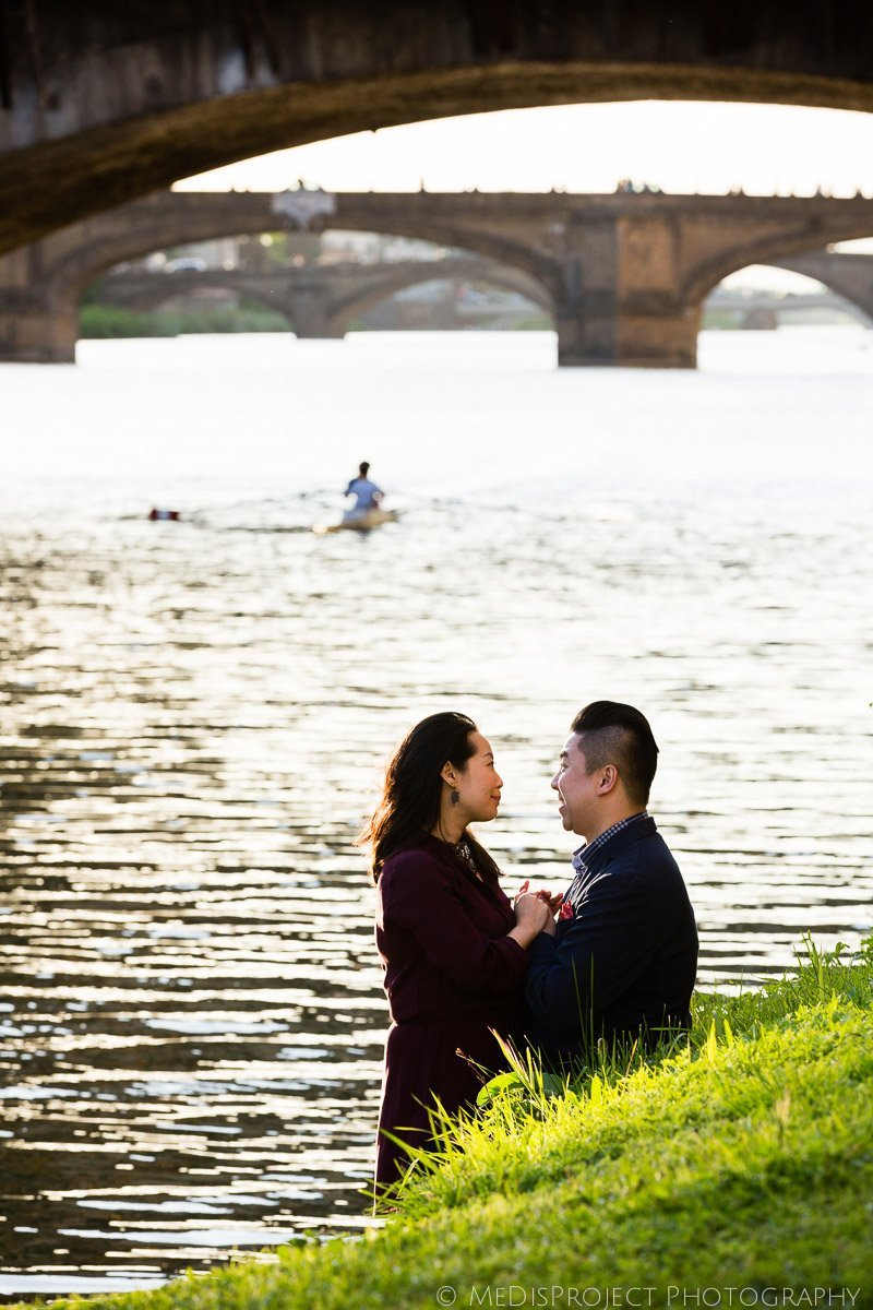 asian couple under the Old Bridge in Florence
