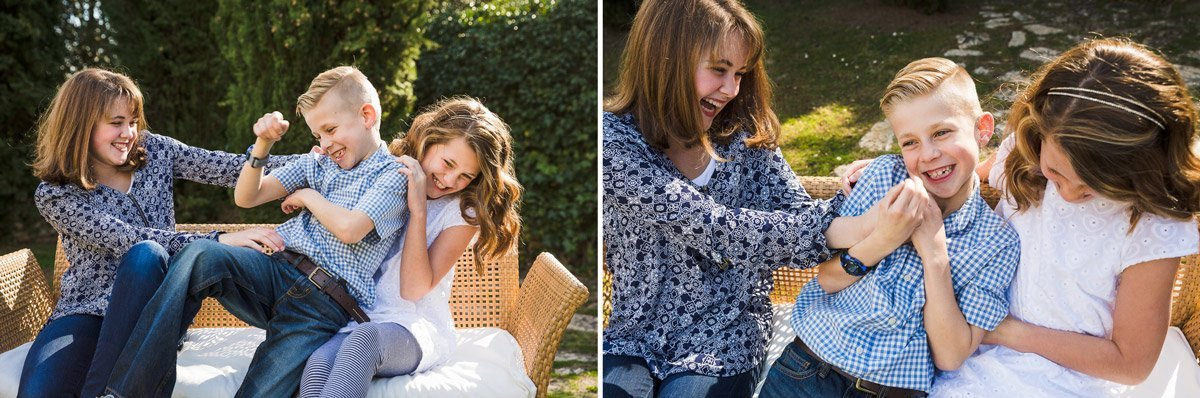 siblings playing tickle-fight during a family photo session in Tuscany
