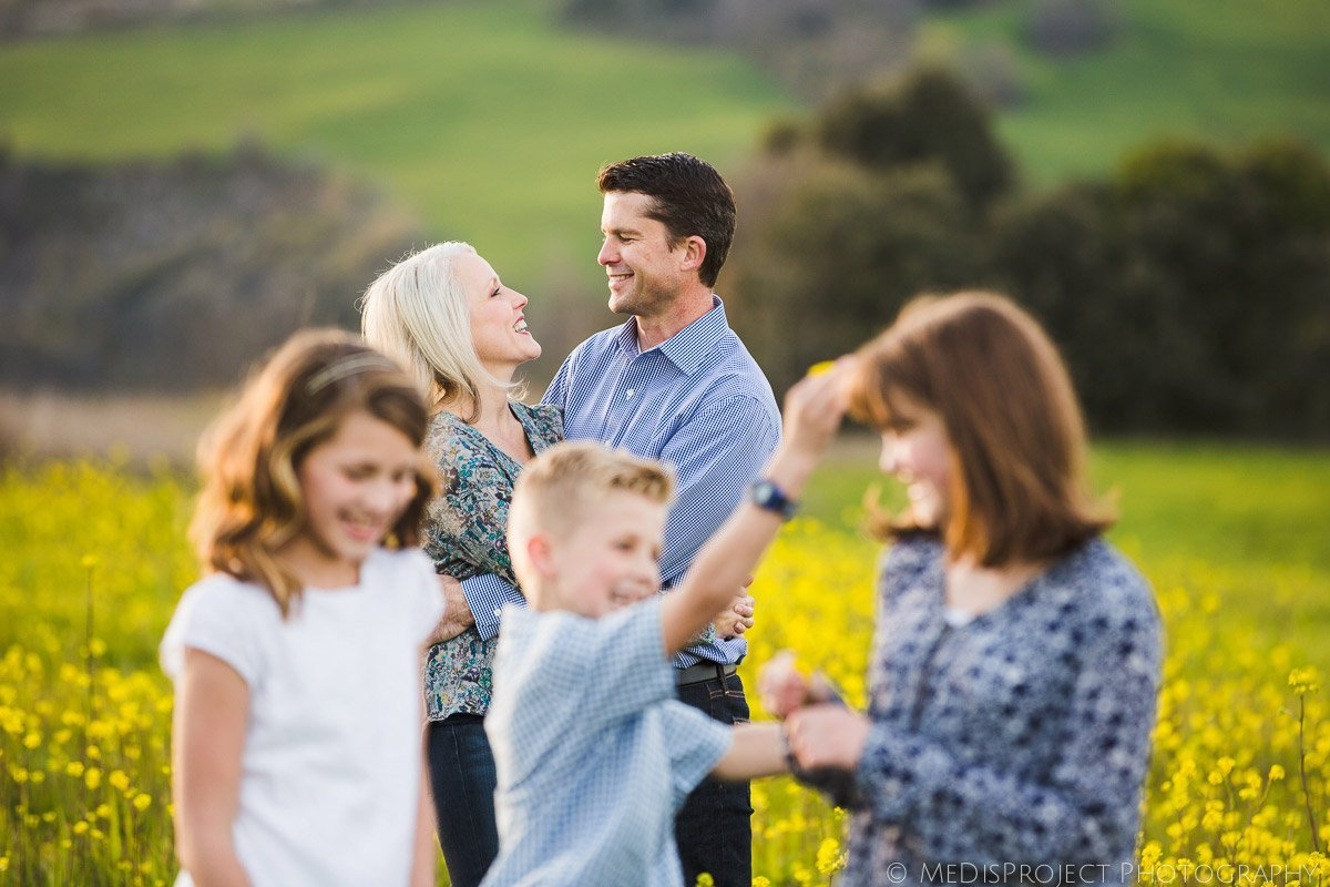 family portrait in a yellow flower field in Tuscany