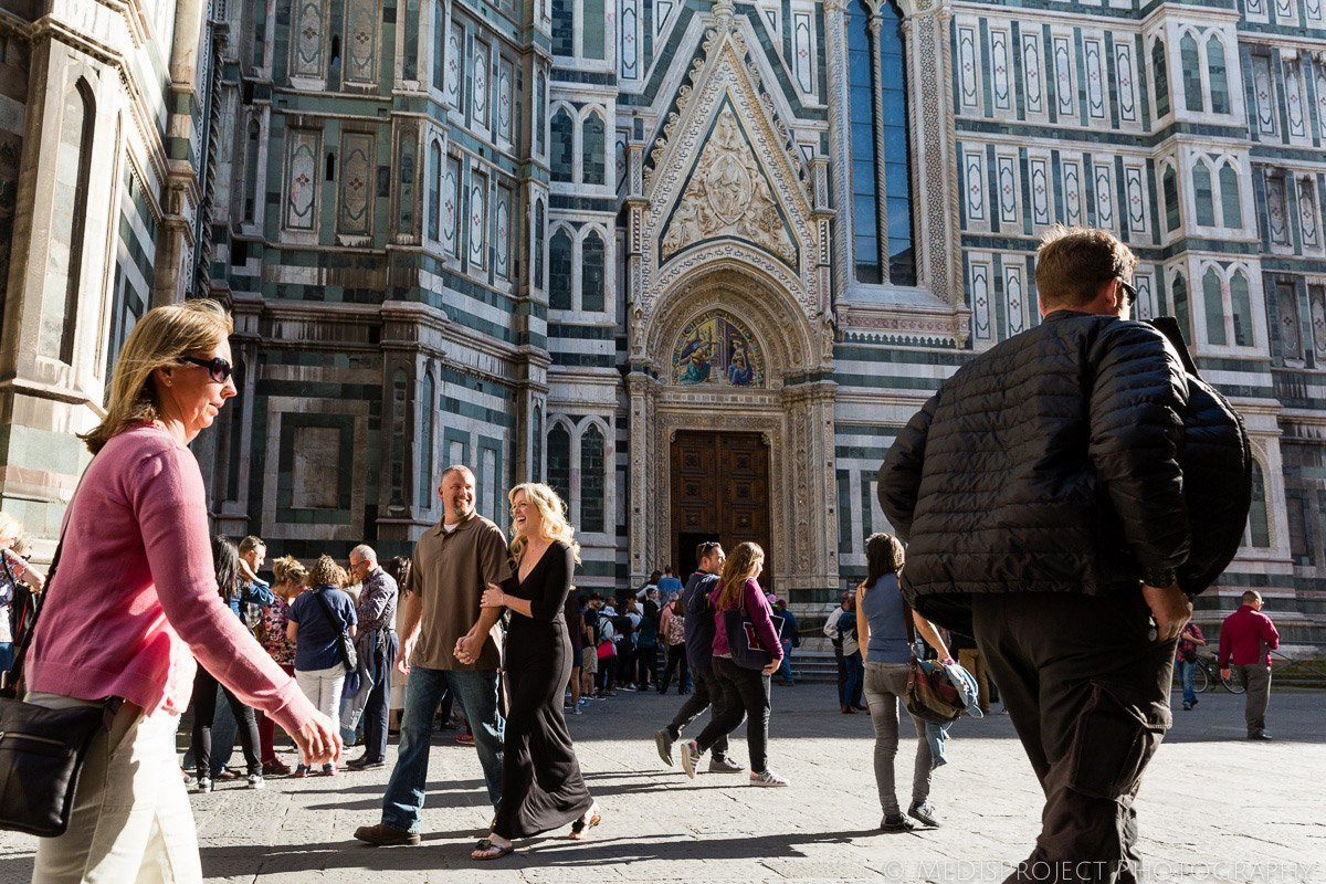 couple strolling in Florence city center