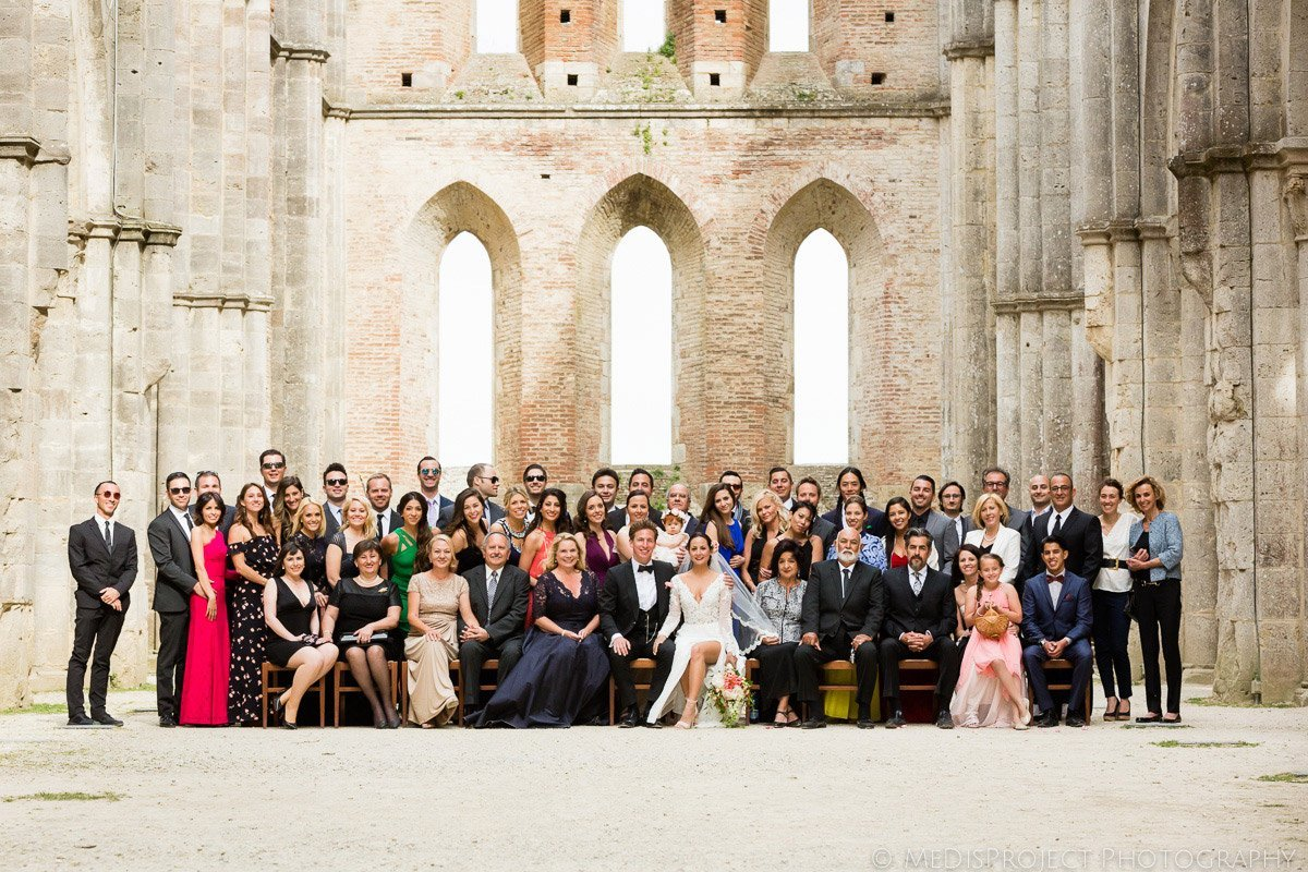 Formal wedding group photo in San Galgano roofless church