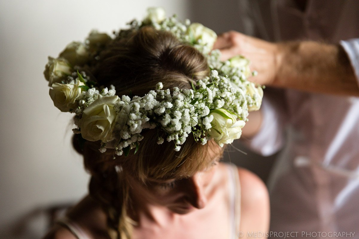 bride wearing a baby's breath crown