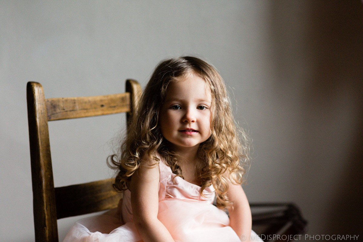 little flower girl portrait before a country Tuscan wedding