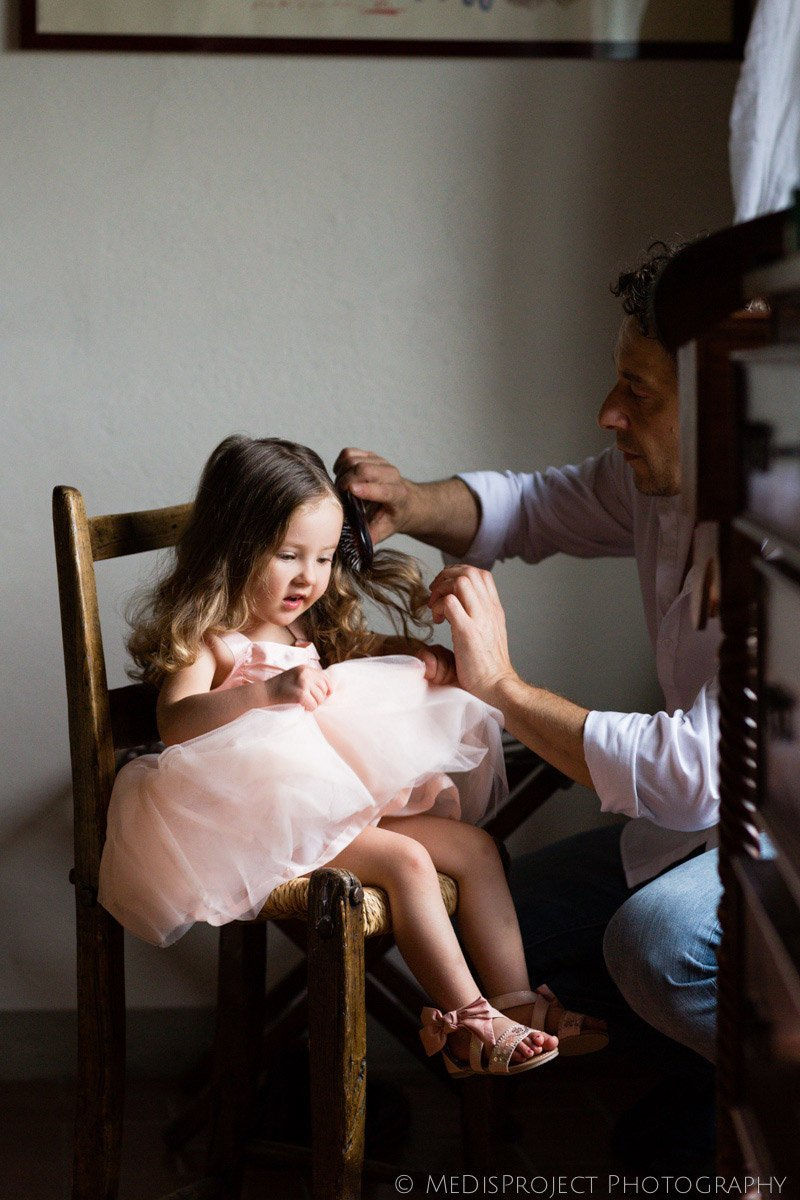 little flower girl getting ready for a wedding at Villa Campestri