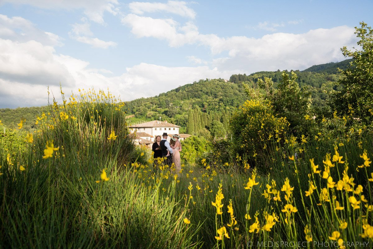 outdoor summer elopement among broom flowers in Tuscany