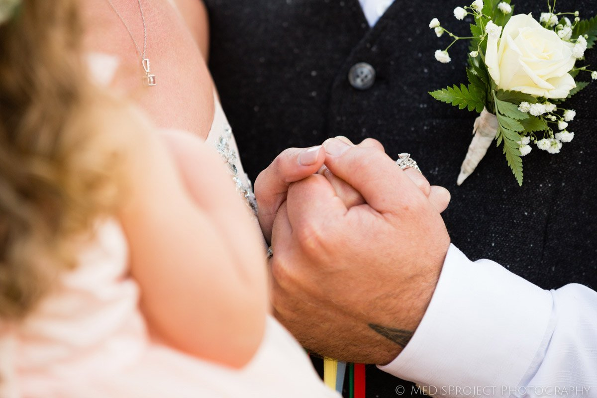 holding hands during an elopement ceremony