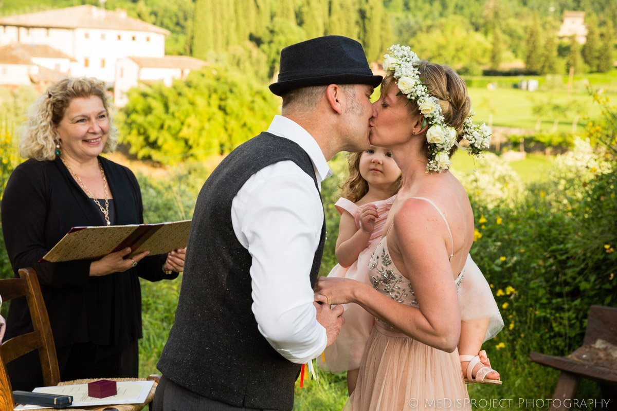 first kiss during an elopement wedding ceremony