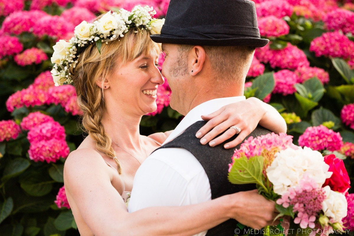 just married couple portrait among rose hydrangea