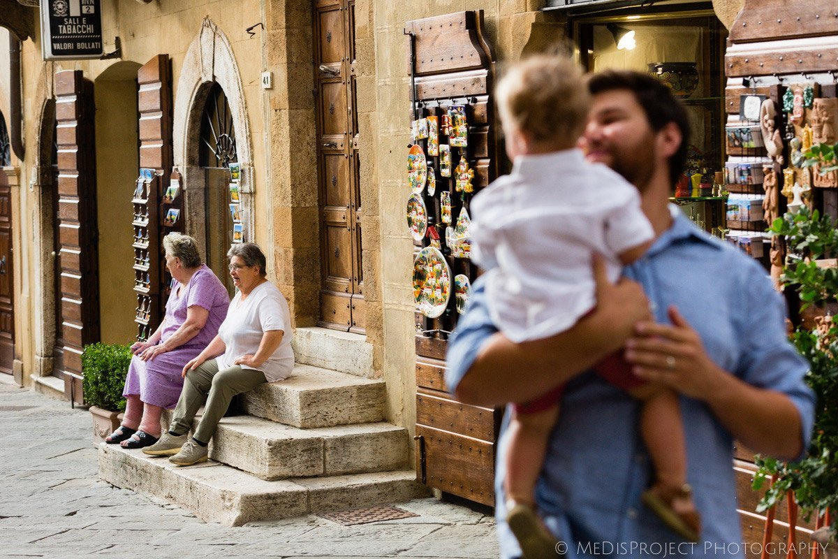 old ladies sitting on the doorstep in Pienza Italy