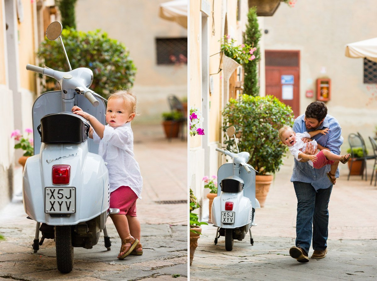 little kid playing with a light blue vespa scooter in Tuscany