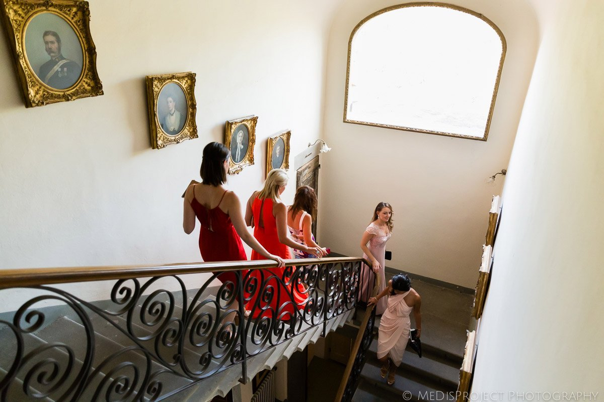 bridal party walking down the stairs to the ceremony