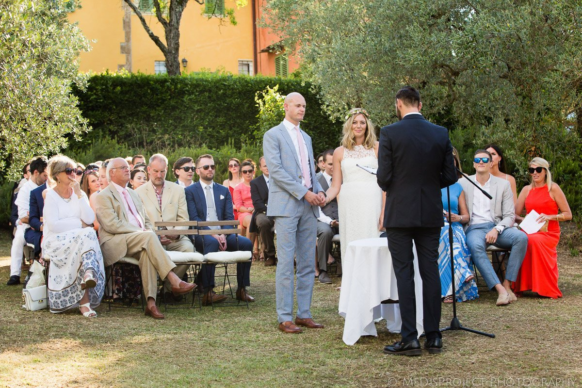 wedding ceremony among olive trees in Tuscany