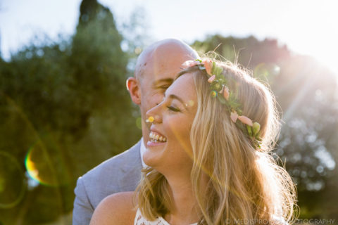 bride and groom close up with flare