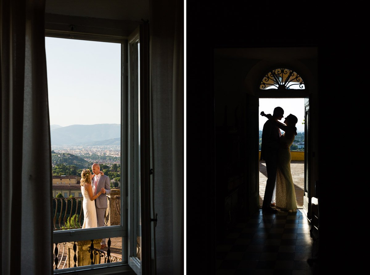 happy couple's silhouette standing by the doorway of an old Tuscan Villa