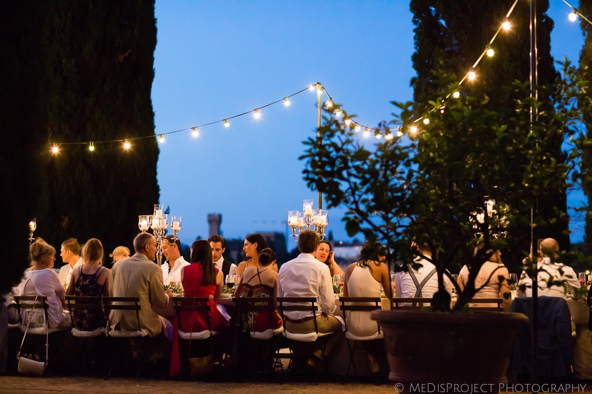 blue hour wedding dinner with fairy bulb lights