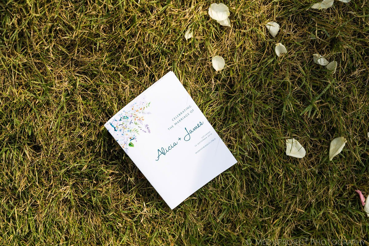 wedding booklet on the grass with petals after the ceremony