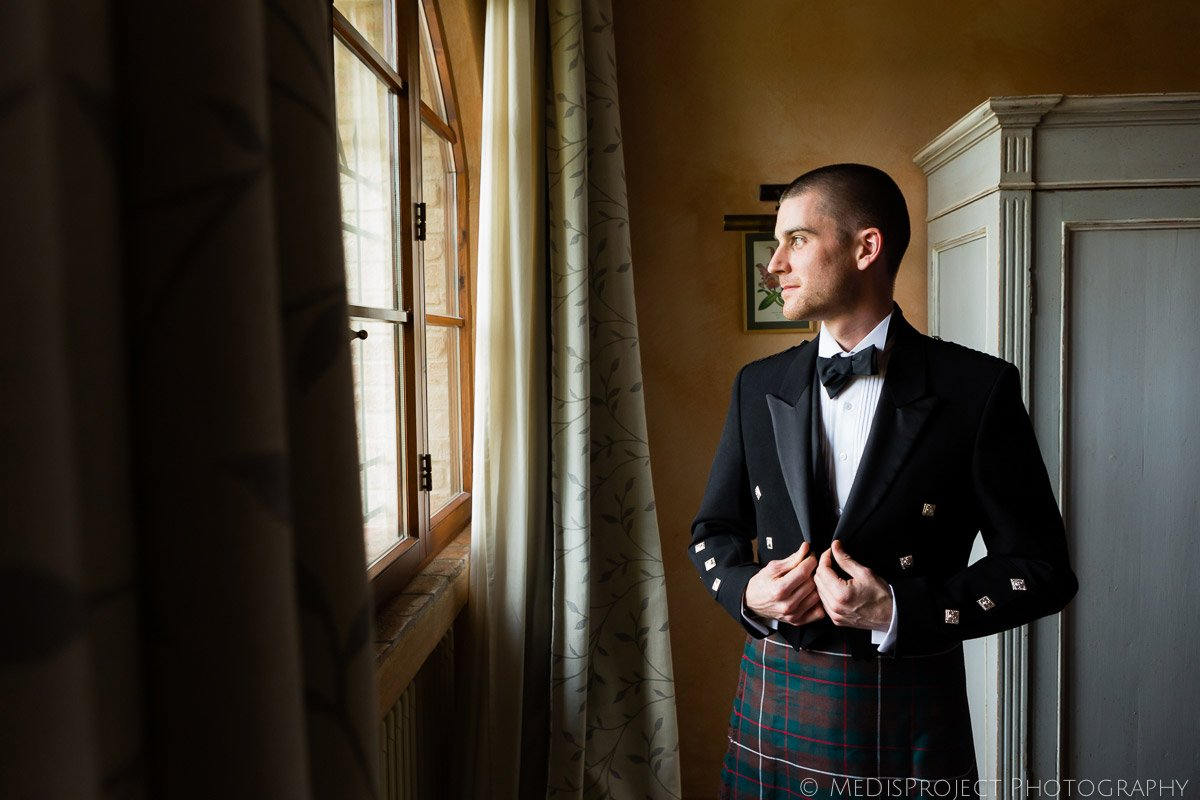 English groom wearing the traditional suit and tartan kilt