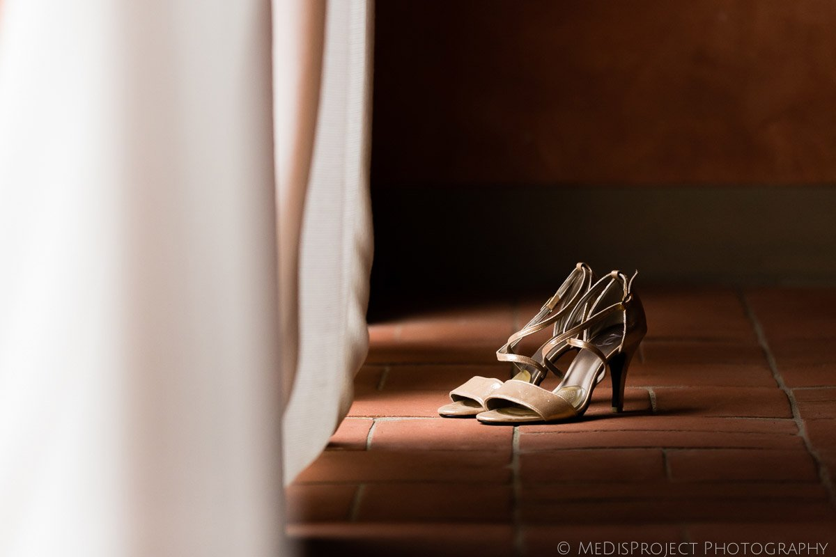 bridal shoes behind the curtains