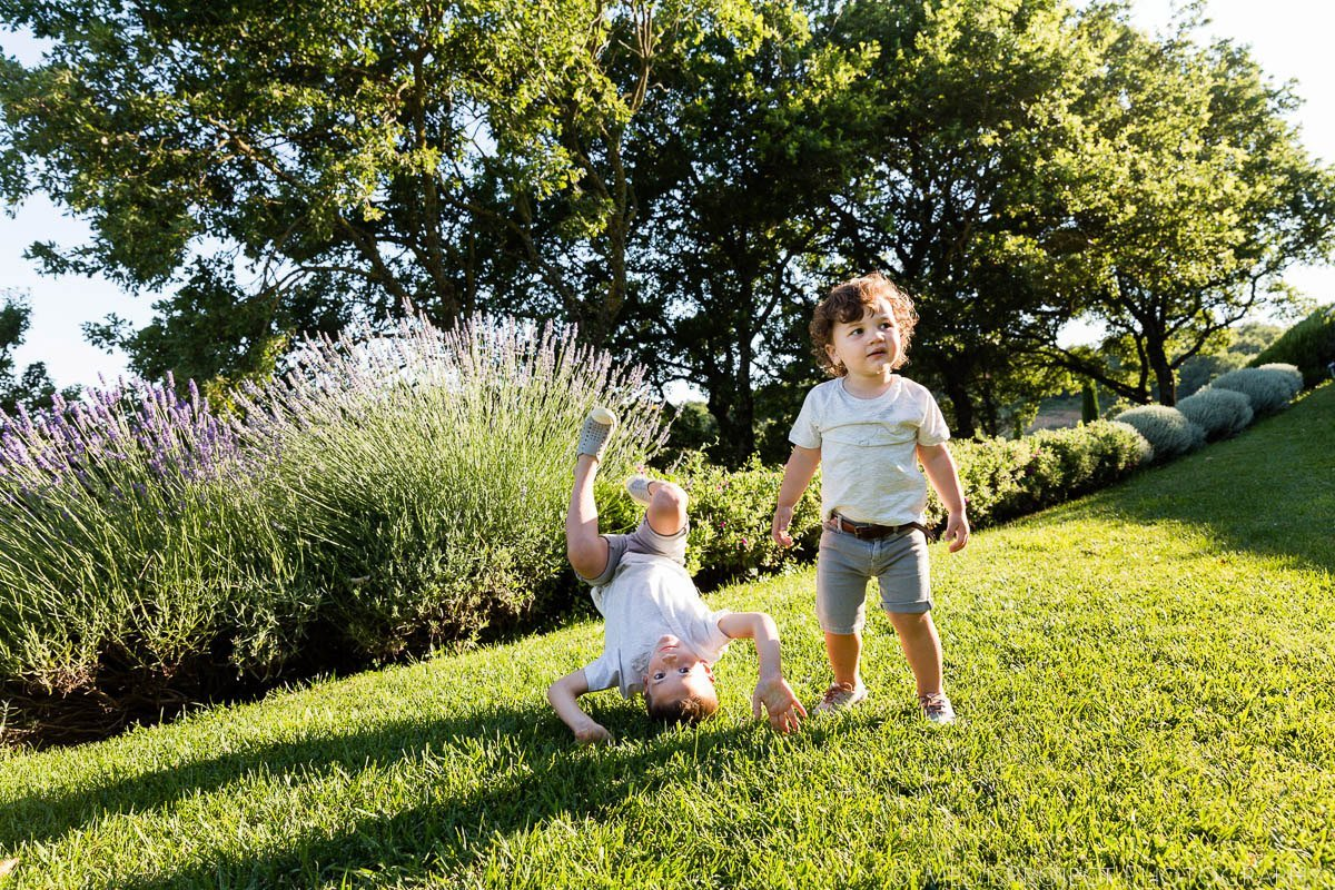 siblings playing in the sunny garden