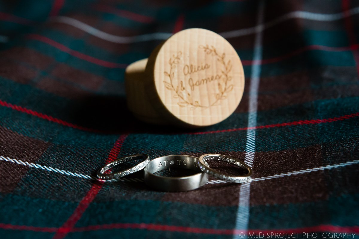 wedding rings on a tartan kilt