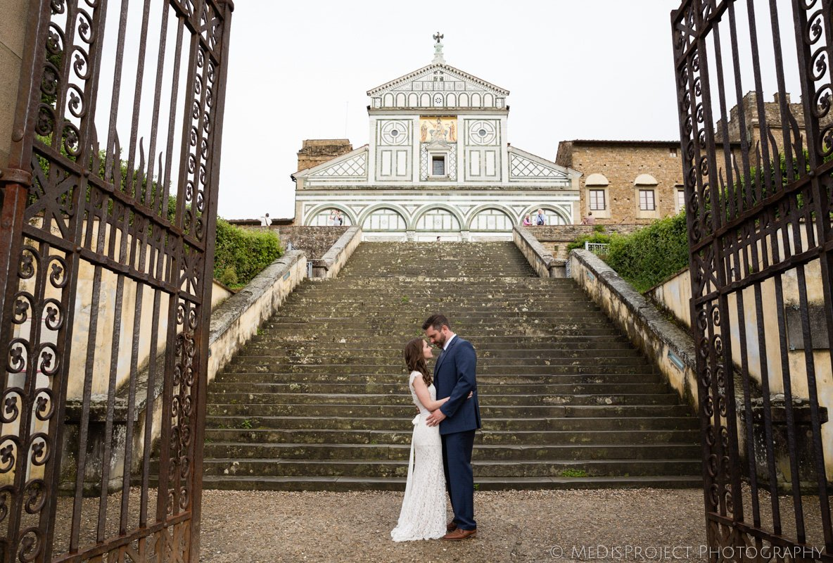 bride and groom in front of San Miniato church Florence