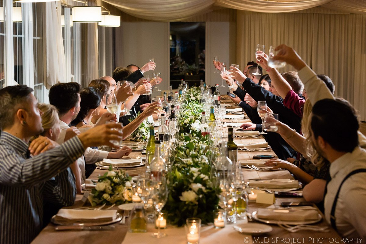 toast to the bride and groom during wedding dinner
