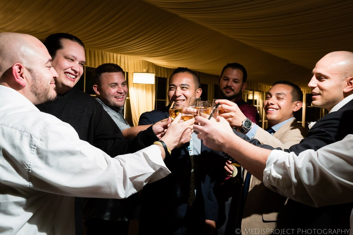 men having a drink during a wedding reception