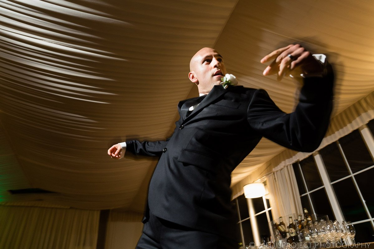 groom dancing at a wedding reception in Italy
