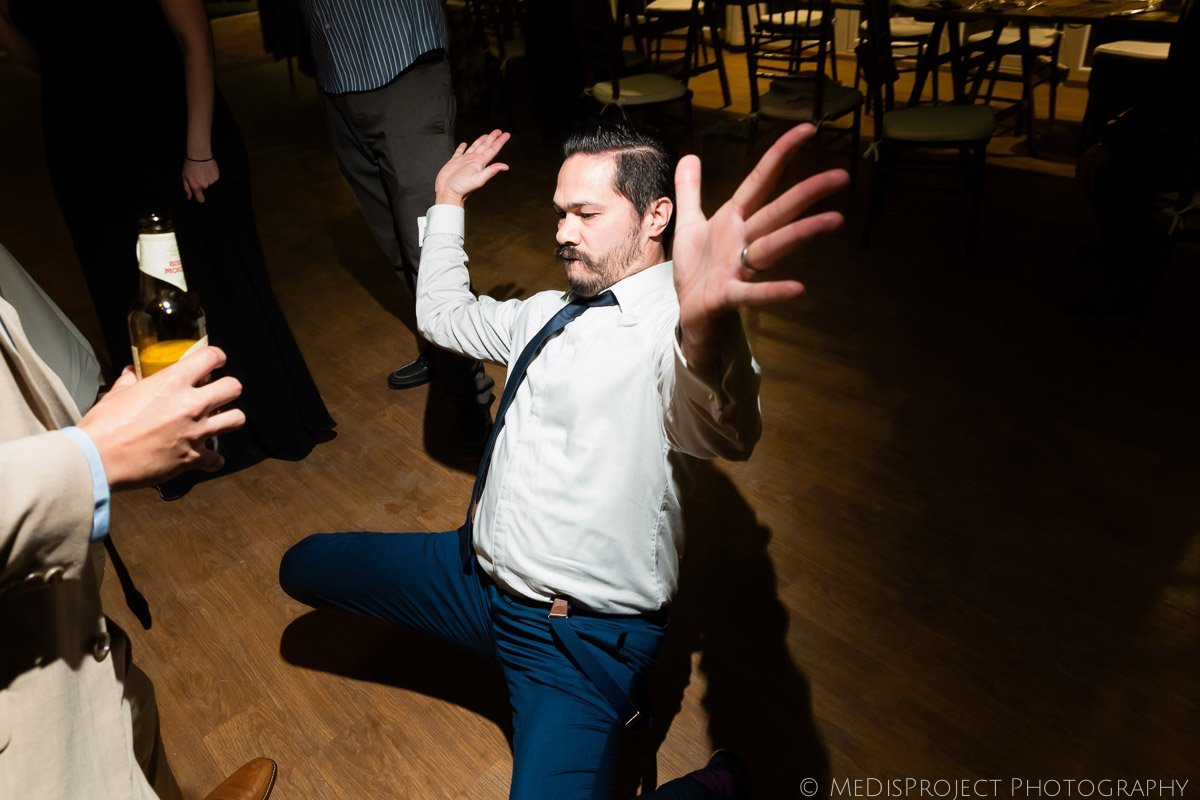man dancing at a wedding reception in Italy
