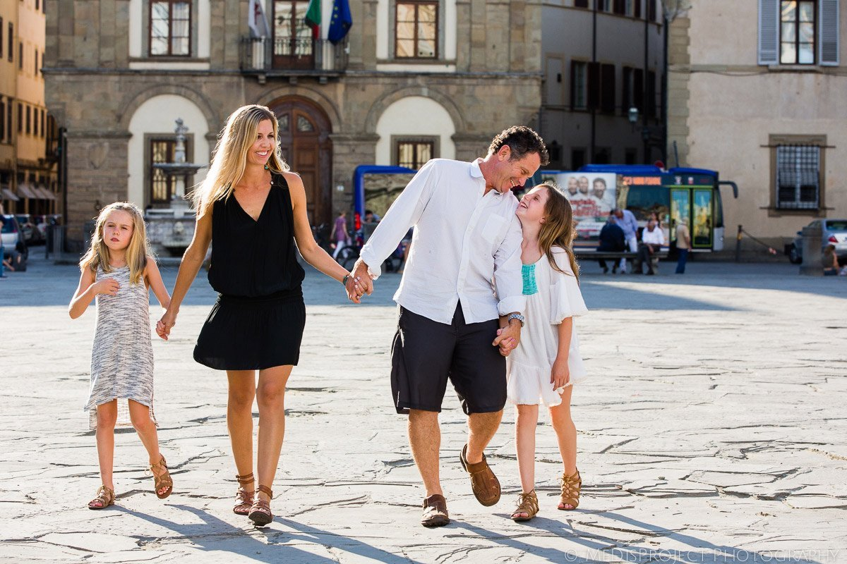 family walking through Piazza Santa Croce in Florence