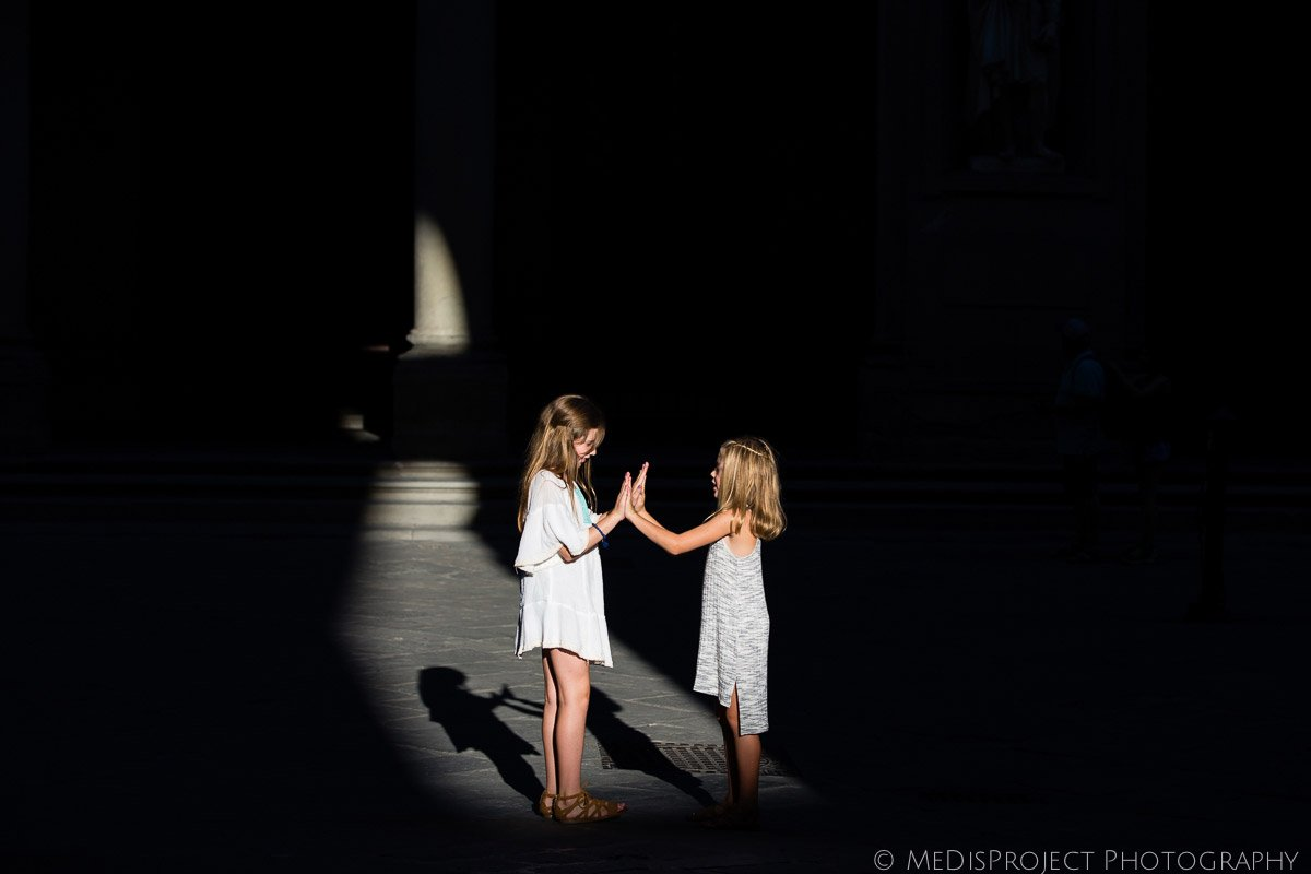 little girls playing hand clapping games in Florence