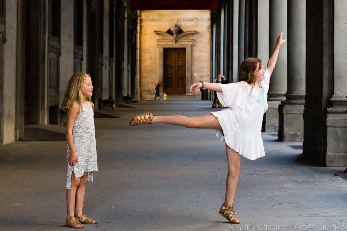 little girls dancing nearby Uffizi gallery in Florence