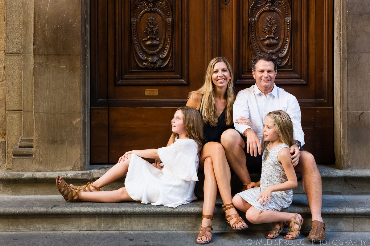 family portrait sitting on the steps