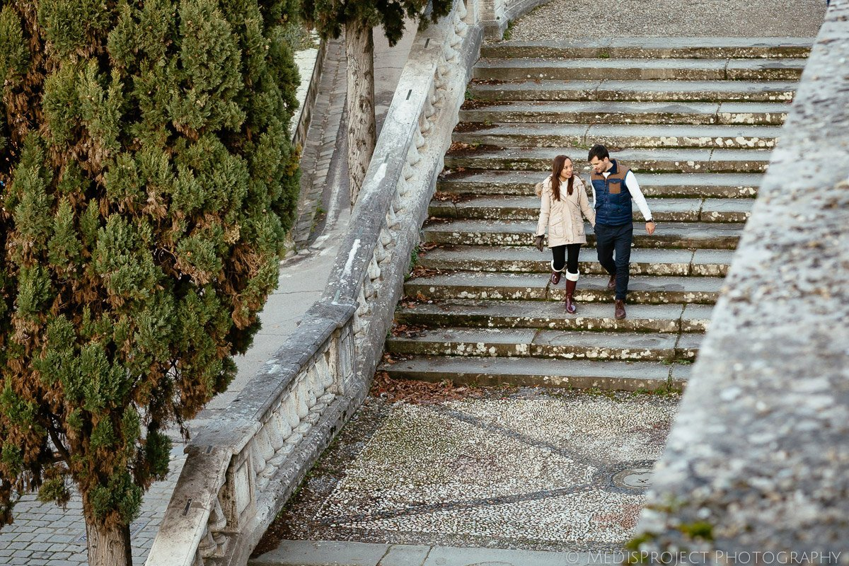 just engaged couple walking down the stairs of San Miniato church in Florence