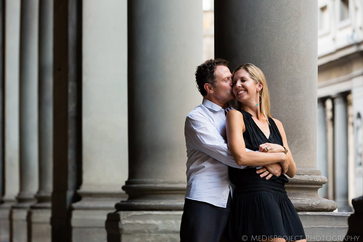 mother and father embracing during a photo shoot in Florence
