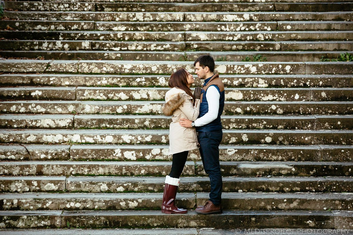 just engaged couple kissing on the stairs of San Miniato church in Florence