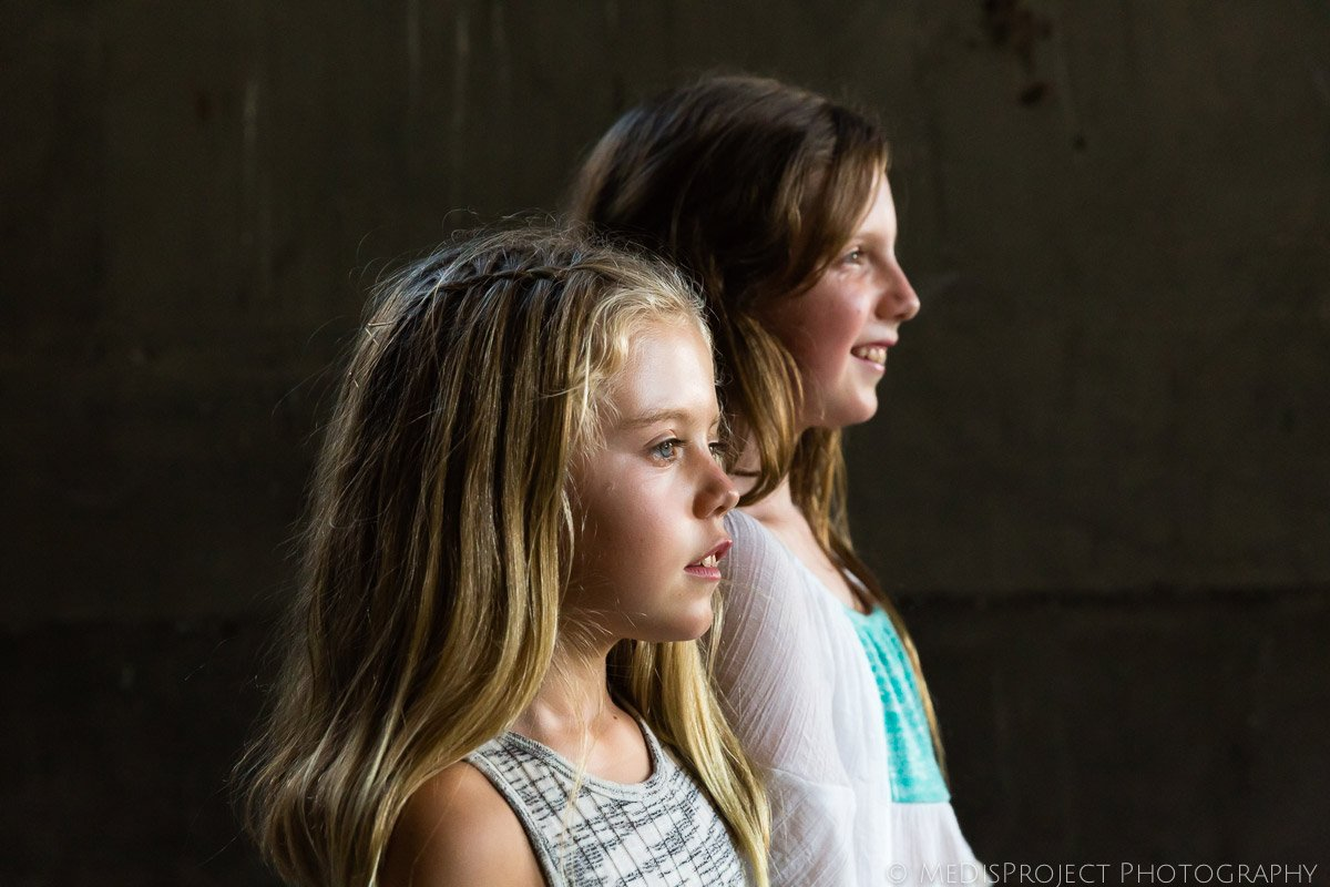 profile of two sisters during a photo session while in Italy