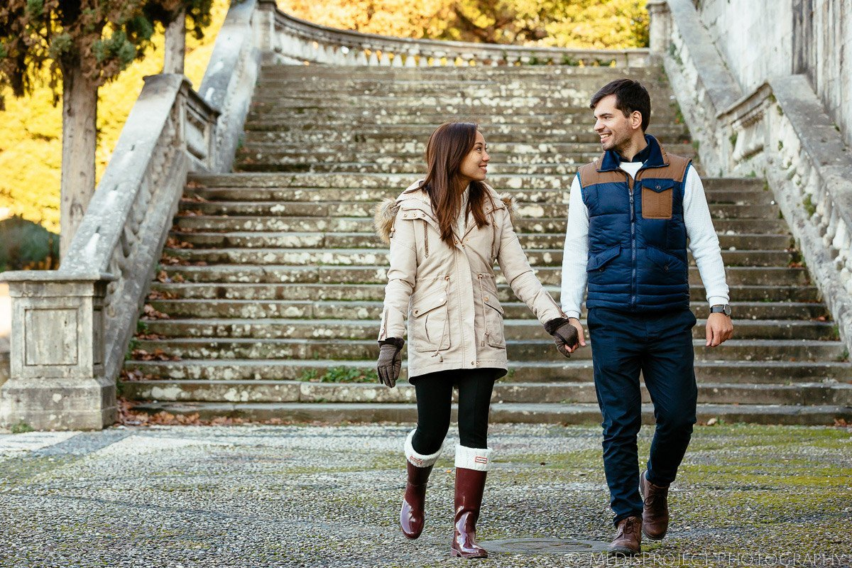 just engaged couple walking hand by hand down the stairs of San Miniato church in Florence