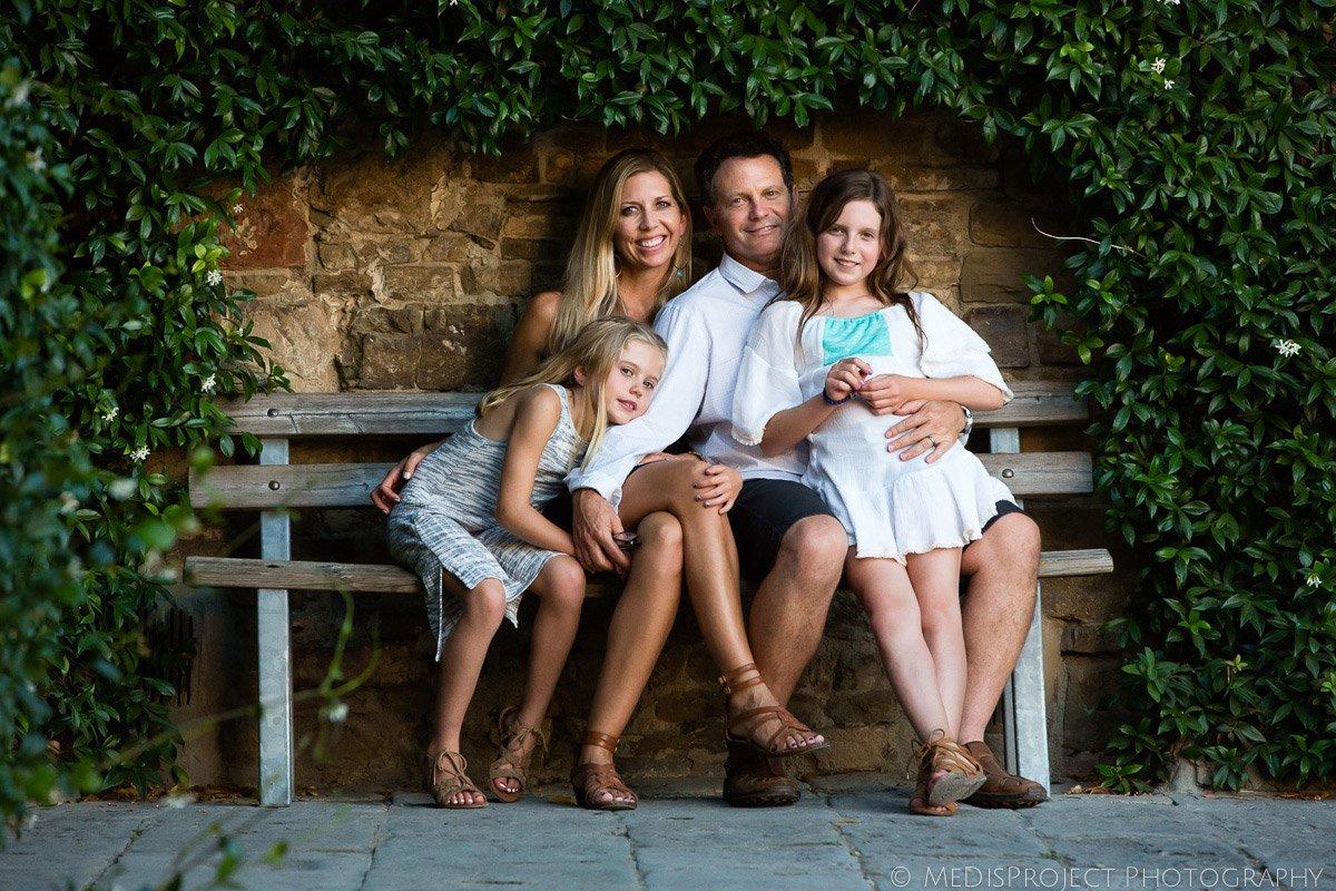 family portrait sitting on a bench next to San Miniato Church