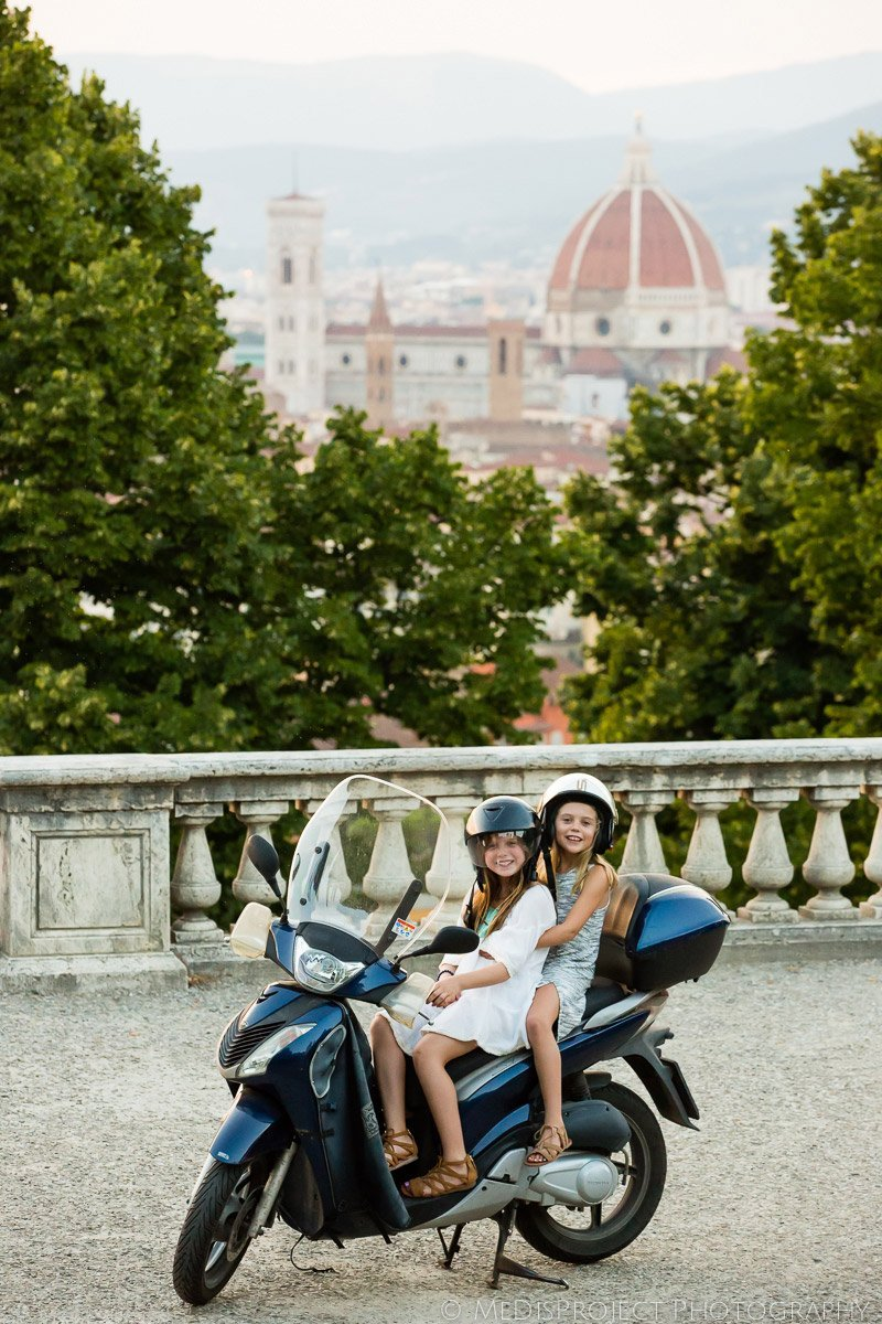 two little girls on a scooter in Florence, Italy