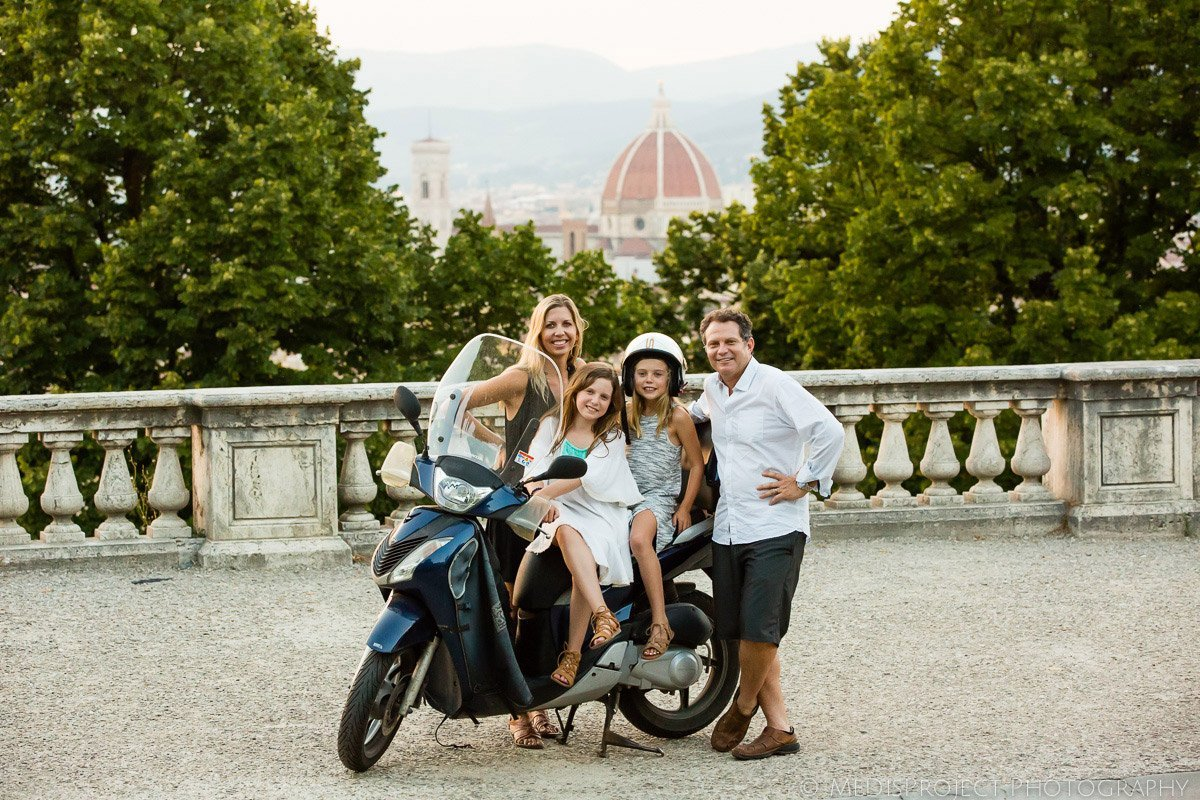 family portrait with a motorbike in Florence Italy