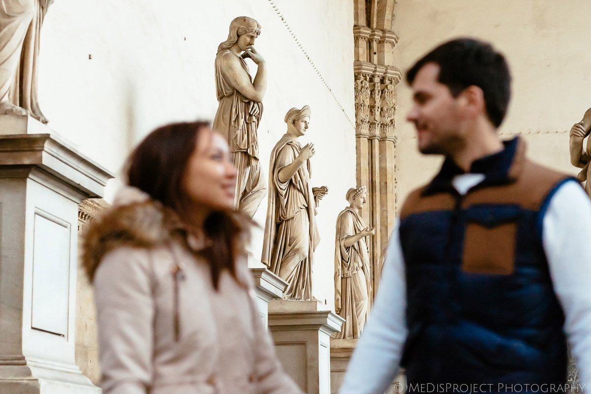 couple visiting historical Florence city center in Italy