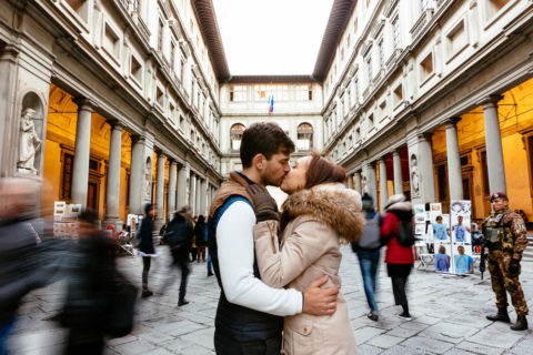 young couple kissing in the Florentine crowd