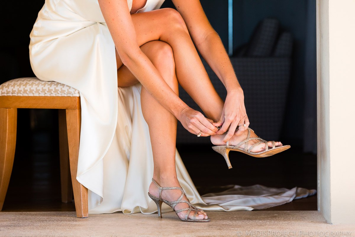 Bride putting her shoes