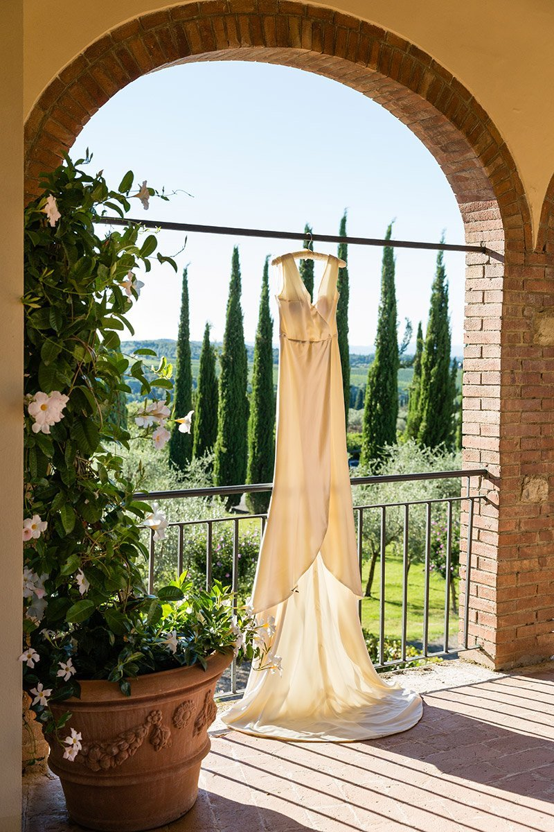 Bridal gown hanging in Borgo San Felice Tuscany