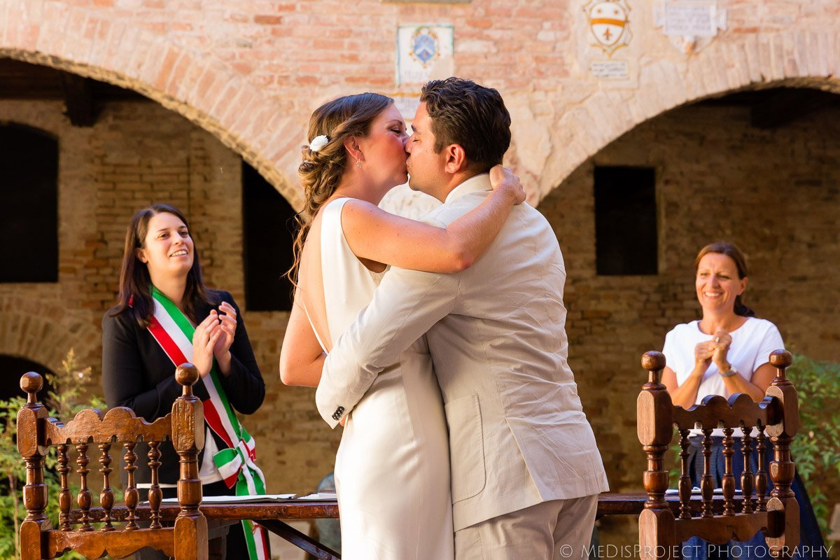 Bride and groom kissing just after the ceremony