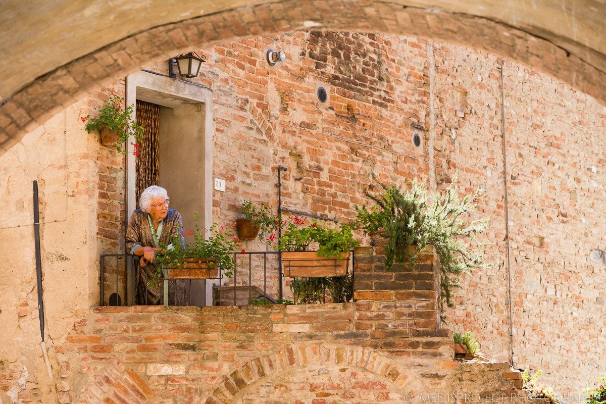 Old lady watching bride and groom in Certaldo Alto