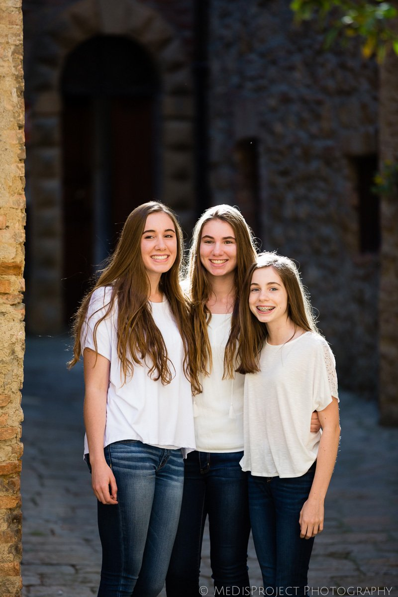 three sisters embrace each other