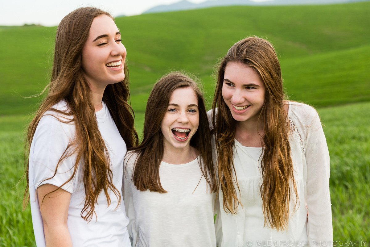 three young girls laughing